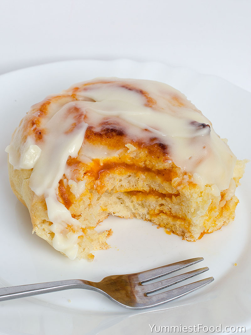 Pumpkin Cinnamon Rolls With Cream Cheese Frosting - served on the plate