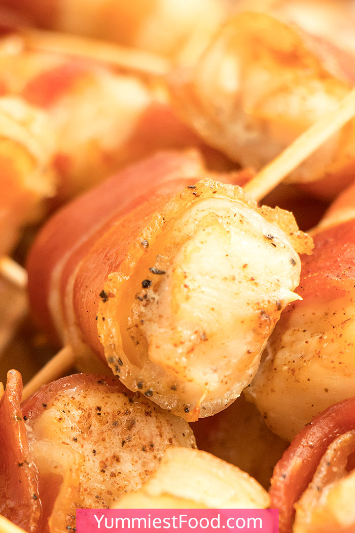 """Brown Sugar Baked Bacon Wrapped Chicken Breasts are perfectly easy and absolutely """"must"""" finger-food appetizer for the game day, gatherings or parties, or quick delicious dinner! Add the basil and honey to the coating of these spiced chicken breasts wrapped in bacon, and fully enjoy these crispy bites! #gameday #gamedayfood #gamedayrecipes #gamedayappetizers #superbowlrecipes #appetizers #dinner #easydinner #dinnerrecipes #chicken #bacon #chickenbreast #chickenrecipes #baconwrappedchicken"""