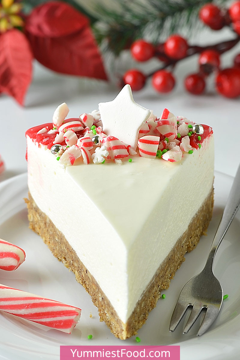 Christmas White Chocolate Cheesecake - Amazing Christmas Cheesecake to make your Holiday season as delicious and magical as you imagine! Simple to make and deliciously creamy with a crumbly Gingerbread crust, white chocolate filling and more! #christmas #christmasrecipes #dessertrecipes #dessertfoodrecipes #easyrecipes #chocolate #cheesecakerecipes #cheesecake